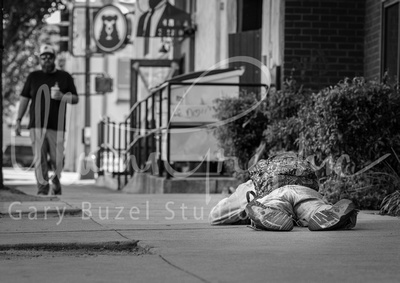 Homeless Man Passed Out on Sidewalk